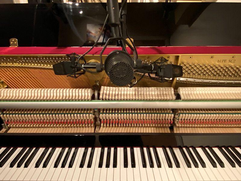 Recording piano in music studio