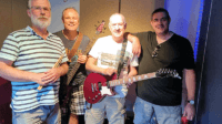 Covers band recording in studio